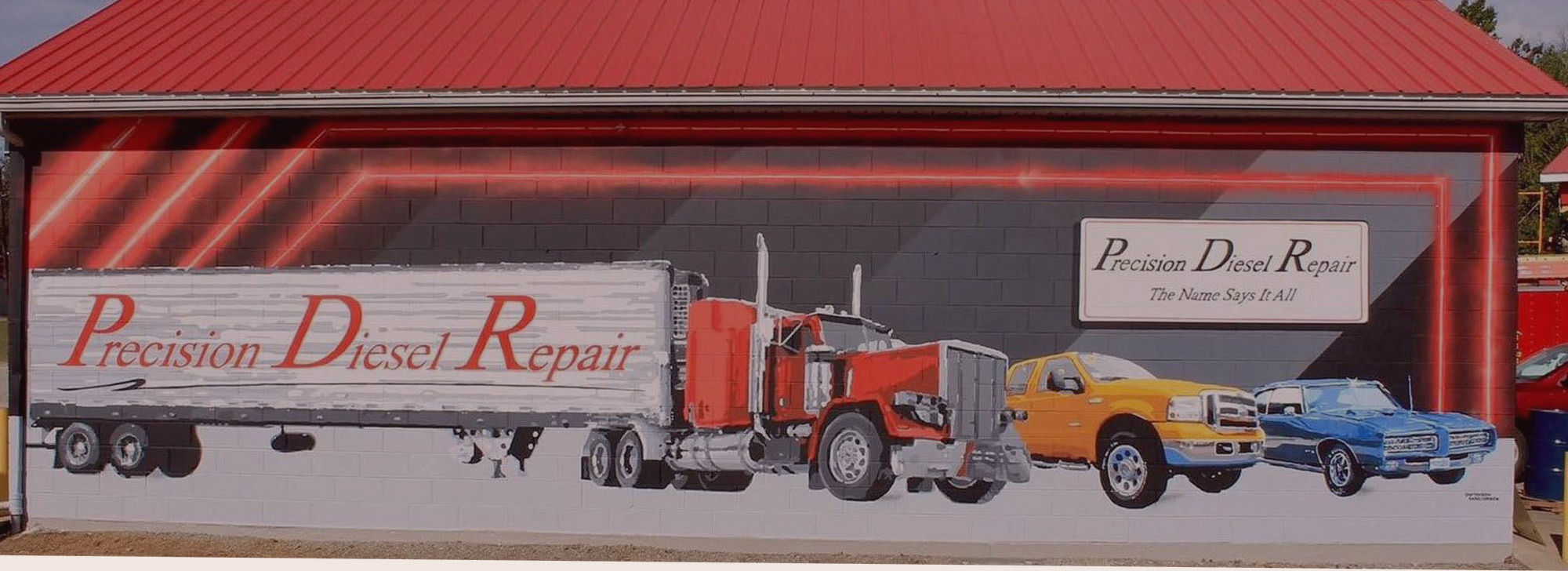 Mural Of Semi Truck, Pickup Truck, And Muscle Car