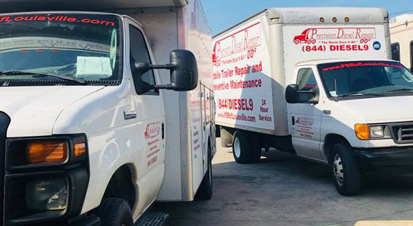 Two Precision Diesel Repair Trucks Parked